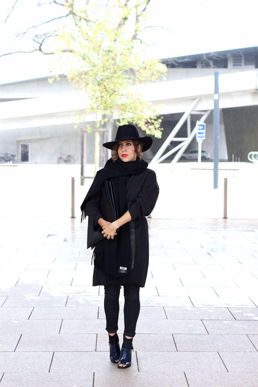 all black outfit hat and acne canada